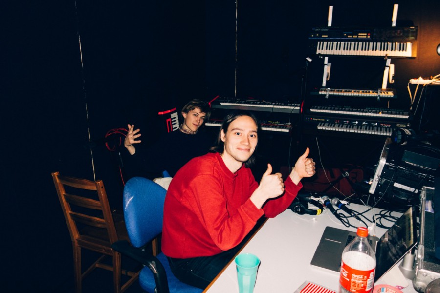 3. Mads and Victor listening to bounces of a hot new demo.